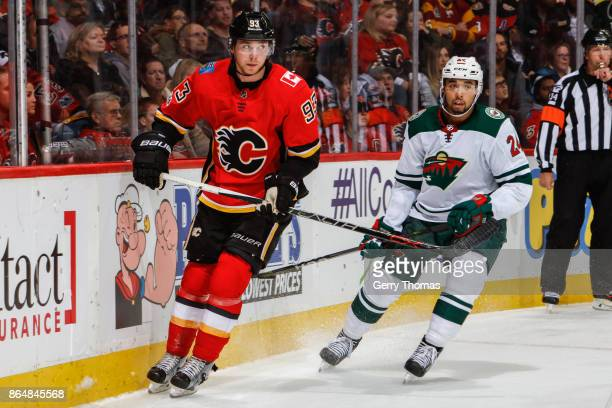 Sam Bennett of the Calgary Flames and Matt Dumba of the Minnesota Wild looking for a pass in an NHL game against the Minnesota Wild at the Scotiabank...