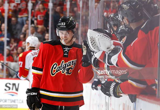 Sam Bennett of the Calgary Flames celebrates with teammates after scoring a goal against the Florida Panthers at Scotiabank Saddledome on January 13...