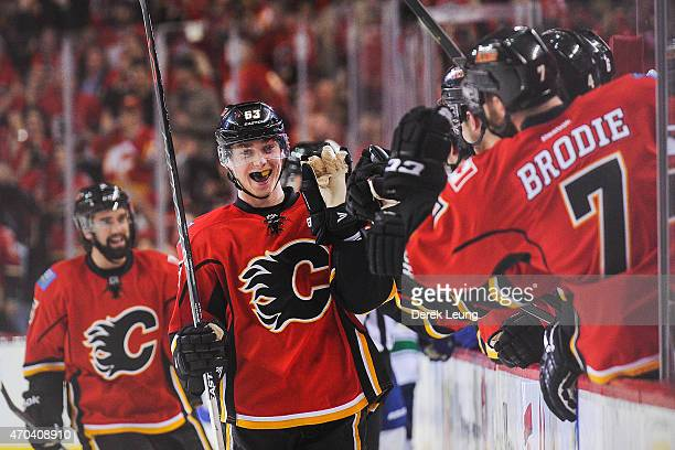 Sam Bennett of the Calgary Flames celebrates with the bench after scoring against the Vancouver Canucks in Game Three of the Western Quarterfinals...