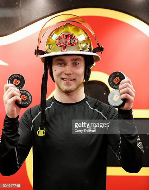 Sam Bennett of the Calgary Flames holds up all four of his goal pucks against the Florida Panthers at Scotiabank Saddledome on January 13 2016 in...