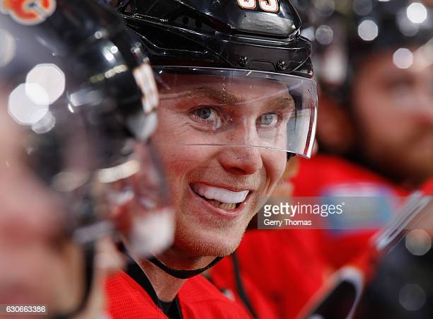 Sam Bennett of the Calgary Flames is all smiles on the bench against the Anaheim Ducks at Scotiabank Saddledome on December 29 2016 in Calgary...