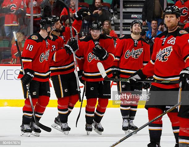 Sam Bennett of the Calgary Flames is congratulated by teammates after a win against the Florida Panthers at Scotiabank Saddledome on January 13 2016...