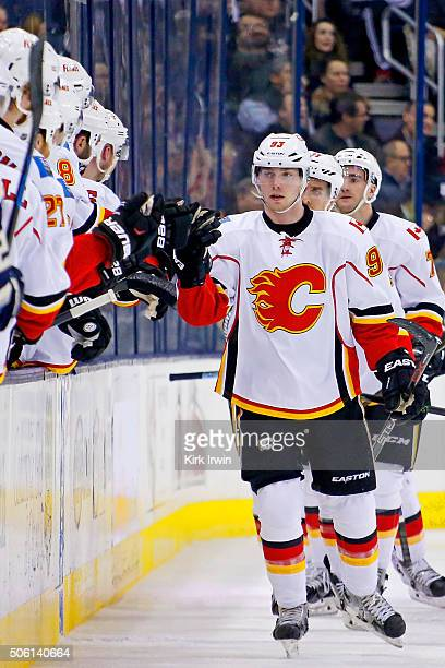 Sam Bennett of the Calgary Flames is congratulated by teammates after scoring a goal during the second period of the game against the Columbus Blue...