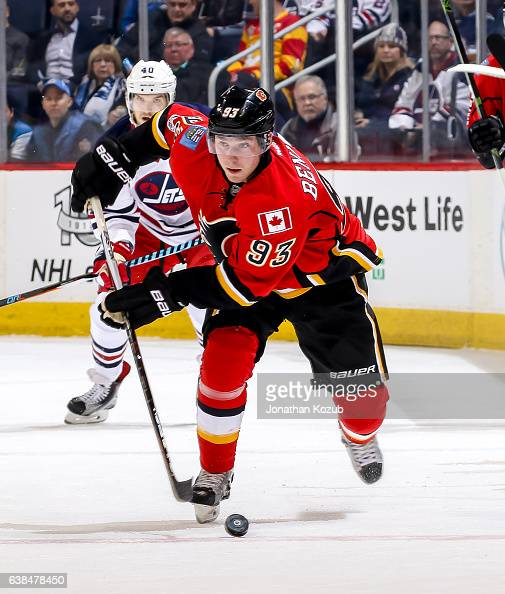 Sam Bennett of the Calgary Flames plays the puck down the ice during first period action against the Winnipeg Jets at the MTS Centre on January 9...