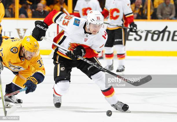 Sam Bennett of the Calgary Flames skates against the Nashville Predators during an NHL game at Bridgestone Arena on October 24 2017 in Nashville...