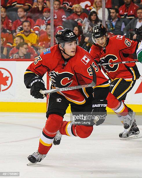 Sam Bennett of the Calgary Flames skates against the Vancouver Canucks in the season opener at Scotiabank Saddledome on October 7 2015 in Calgary...