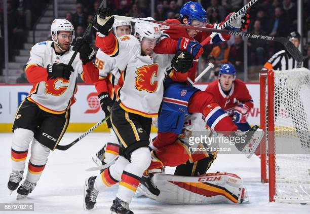 Sam Bennett of the Calgary Flames tries to slow down Charles Hudon of the Montreal Canadiens in the NHL game at the Bell Centre on December 7 2017 in...