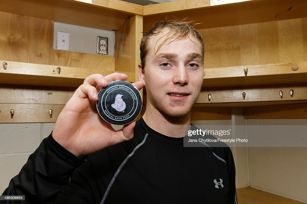 <a gi-track='captionPersonalityLinkClicked' href=/galleries/search?phrase=Sam+Bennett+-+Ice+Hockey+Player&family=editorial&specificpeople=12707460 ng-click='$event.stopPropagation()'>Sam Bennett</a> #93 of the Calgary Flames with the puck with which he scored his career NHL goal during an NHL game against the Ottawa Senators at Canadian Tire Centre on October 28, 2015 in Ottawa, Ontario, Canada.