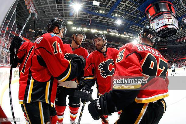 Sam Bennett TJ Brodie and teammates of the Calgary Flames celebrate a goal against the San Jose Sharks during an NHL game at Scotiabank Saddledome on...