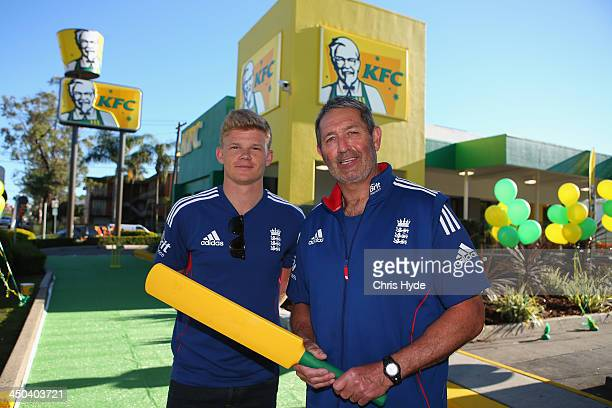 Sam Billings and Graham Gooch pose infront of KFC in Brisbane transformed to Green Gold in support of Australian Cricket on November 19 2013 in...