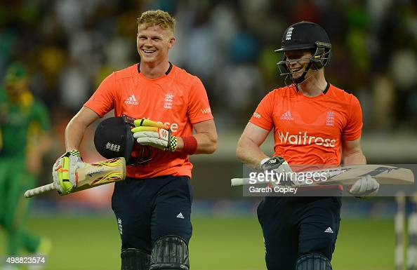 Sam Billings leaves the field alongside England captain Eoin Morgan after their innings during the 1st International T20 match between Pakistan and...