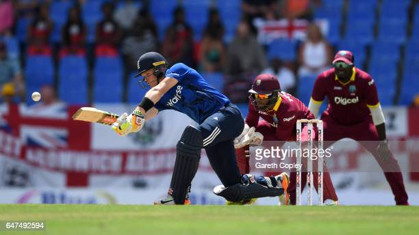 Sam Billings of England bats during the first One Day International between the West Indies and England at Sir Vivian Richards Cricket Ground on...