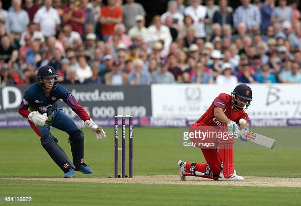 Sam Billings of Kent looks on as Ashwell Prince of Lancashire scores runs during the NatWest T20 Blast quarter final match between Kent Spitfires and...