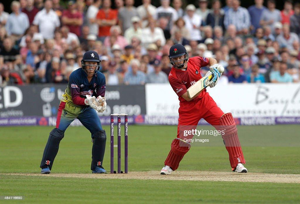 Sam Billings of Kent looks on as Joss Butler of Lancashire scores runs during the NatWest T20 Blast quarter final match between Kent Spitfires and...