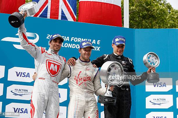 Sam Bird Jerome d'Ambrosio and Loic Duval celebrate on the podium at Battersea Park Track on June 28 2015 in London England
