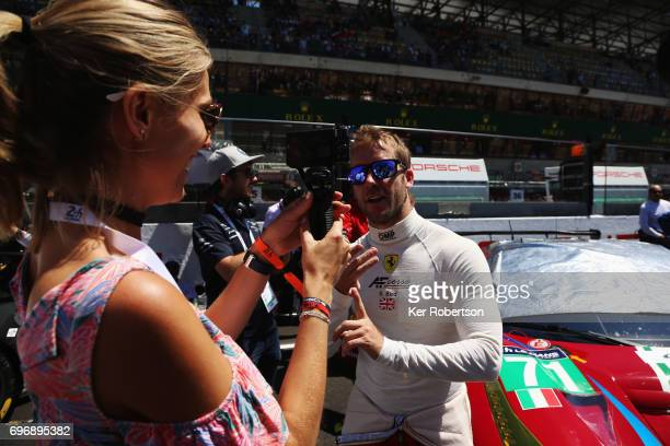 Sam Bird of AF Corse Ferrari interviewed on the grid before the Le Mans 24 Hours race at the Circuit de la Sarthe on June 17 2017 in Le Mans France