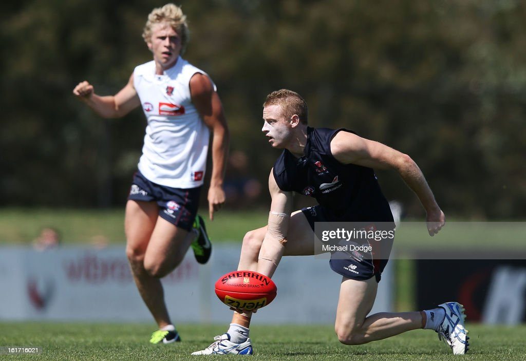 Sam Blease looks to handpass the ball during a Melbourne Demons intra-club match session at Casey Fields on February 15, 2013 in Melbourne, Australia.