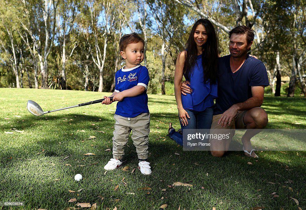Sam Blewett 'The Little Aussie Golfer' poses with his parents Greg and Katheryn duing a portrait session on November 27, 2016 in Adelaide, Australia. At just 22 months old, Sam, the son of former Australian Test Cricketer Greg Blewett and wife Katheryn Blewett, has become an international star as social media videos of his golfing skills and antics have gone viral.