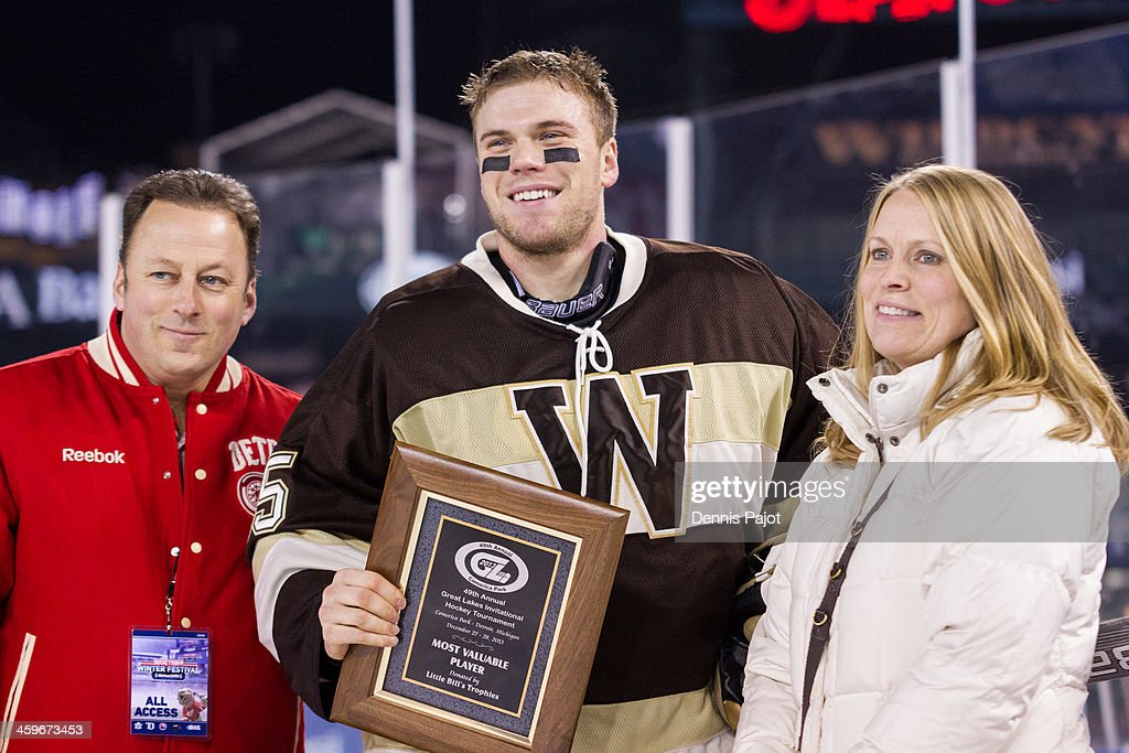 Sam Bloomberg #28 is awarded the MVP trophy after a 1-0 overtime win in the GLI championship game over the Michigan Tech Huskies on December 28, 2013 at Comerica Park in Detroit, Michigan.