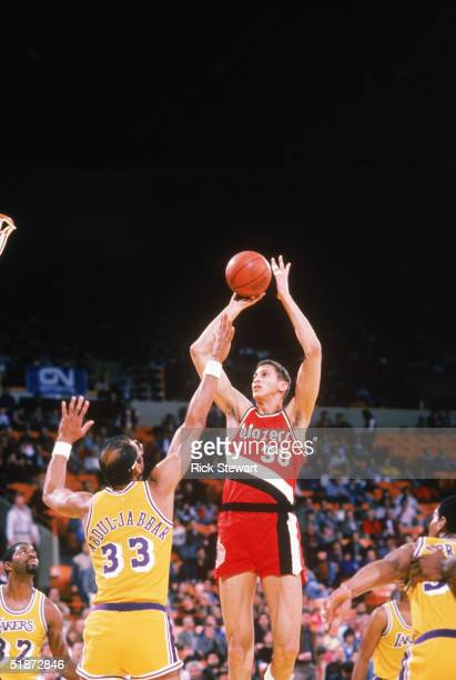 Sam Bowie of the Portland Trail Blazers shoots over Kareem AbdulJabbar of the Los Angeles Lakers during a game circa 19841988 at the Great Western...