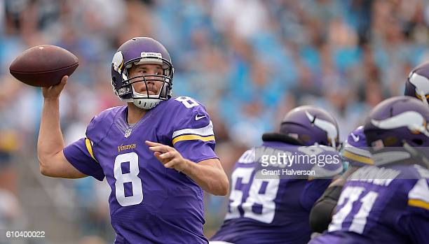 Sam Bradford of the Minnesota Vikings throws a pass against the Carolina Panthers in the 3rd quarter during the game at Bank of America Stadium on...