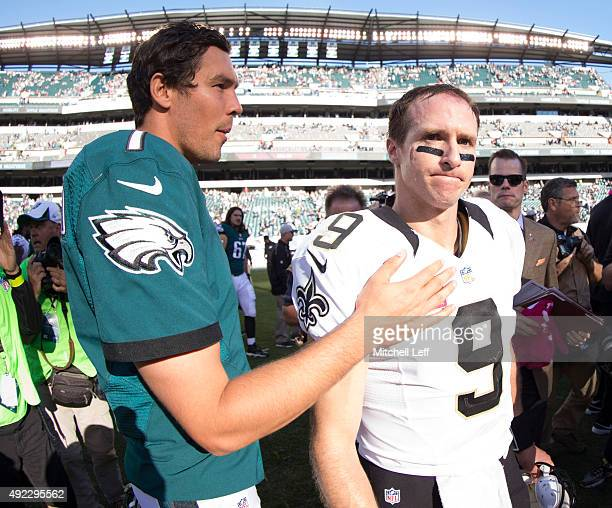Sam Bradford of the Philadelphia Eagles greets Drew Brees of the New Orleans Saints after the game on October 11 2015 at Lincoln Financial field in...