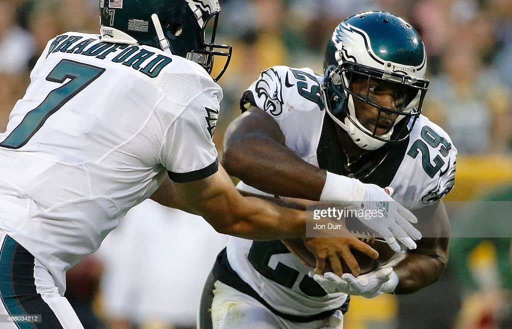 Sam Bradford of the Philadelphia Eagles hands the ball off to DeMarco Murray during a preseason game at Lambeau Field on August 29 2015 in Green Bay...