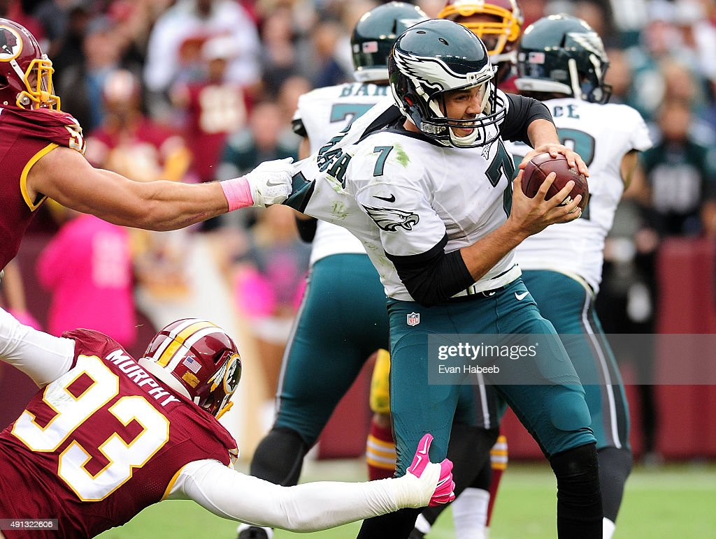 Sam Bradford of the Philadelphia Eagles is sacked by Trent Murphy of the Washington Redskins in the fourth quarter at FedExField on October 4 2015 in...