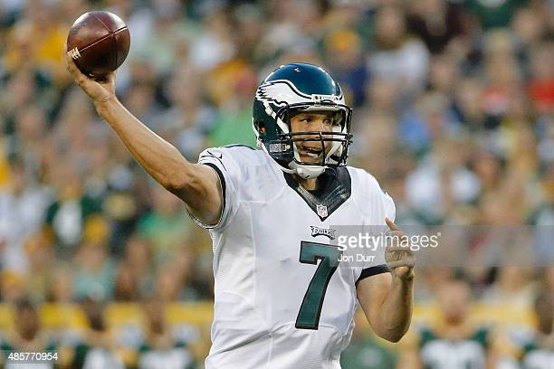 Sam Bradford of the Philadelphia Eagles passes the ball against the Green Bay Packers during the first quarter in a preseason game at Lambeau Field...