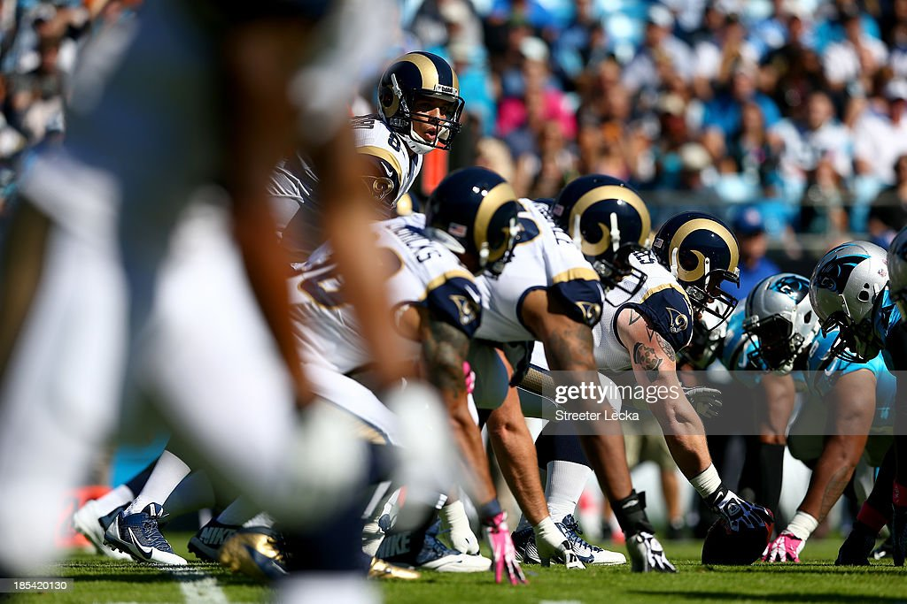 <a gi-track='captionPersonalityLinkClicked' href=/galleries/search?phrase=Sam+Bradford&family=editorial&specificpeople=4489292 ng-click='$event.stopPropagation()'>Sam Bradford</a> #8 of the St. Louis Rams calls a play against the Carolina Panthers during their game at Bank of America Stadium on October 20, 2013 in Charlotte, North Carolina.