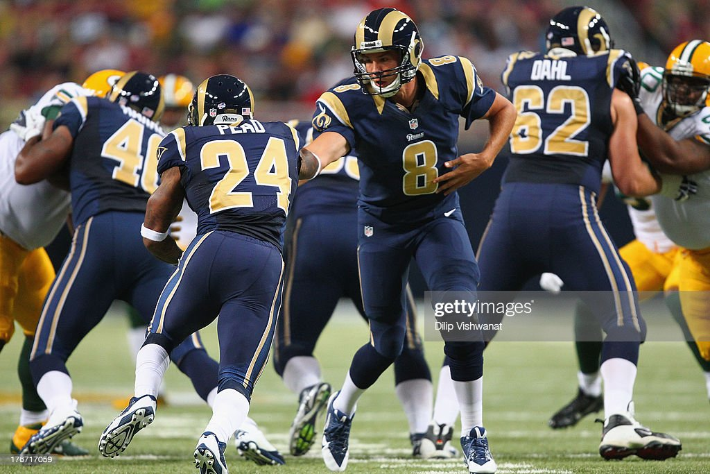 <a gi-track='captionPersonalityLinkClicked' href=/galleries/search?phrase=Sam+Bradford&family=editorial&specificpeople=4489292 ng-click='$event.stopPropagation()'>Sam Bradford</a> #8 of the St. Louis Rams hands the ball off to Isaiah Pead #24 of the St. Louis Rams during a preseason game against the Green Bay Packers at the Edward Jones Dome on August 17, 2013 in St. Louis, Missouri.
