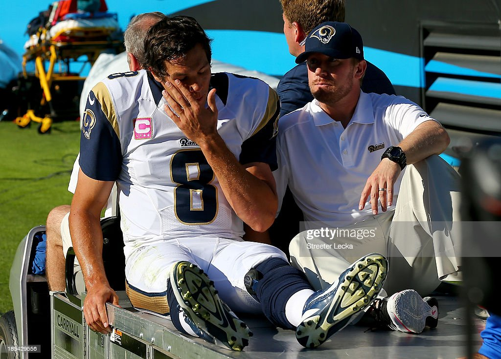 CHARLOTTE, NC - OCTOBER <a gi-track='captionPersonalityLinkClicked' href=/galleries/search?phrase=Sam+Bradford&family=editorial&specificpeople=4489292 ng-click='$event.stopPropagation()'>Sam Bradford</a> #8 of the St. Louis Rams is carted off the field after he is injured after being knocked out of bounds by Mike Mitchell #21 of the Carolina Panthers during their game at Bank of America Stadium on October 20, 2013 in Charlotte, North Carolina.