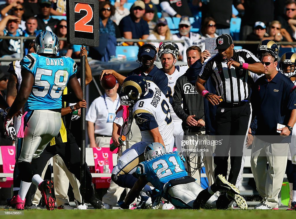 CHARLOTTE, NC - OCTOBER <a gi-track='captionPersonalityLinkClicked' href=/galleries/search?phrase=Sam+Bradford&family=editorial&specificpeople=4489292 ng-click='$event.stopPropagation()'>Sam Bradford</a> #8 of the St. Louis Rams is injured as he is knocked out of bounds by Mike Mitchell #21 of the Carolina Panthers during their game at Bank of America Stadium on October 20, 2013 in Charlotte, North Carolina.