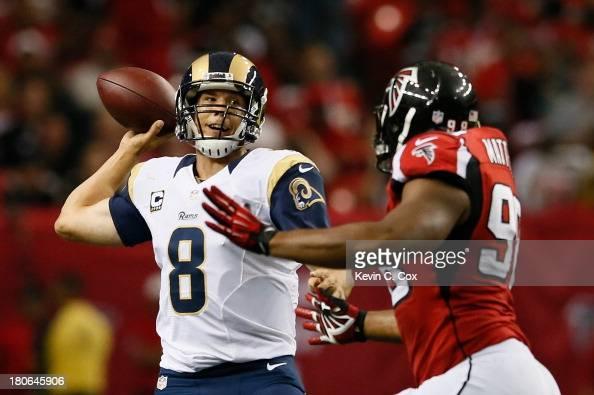 Sam Bradford of the St Louis Rams is pressured by Cliff Matthews of the Atlanta Falcons at Georgia Dome on September 15 2013 in Atlanta Georgia
