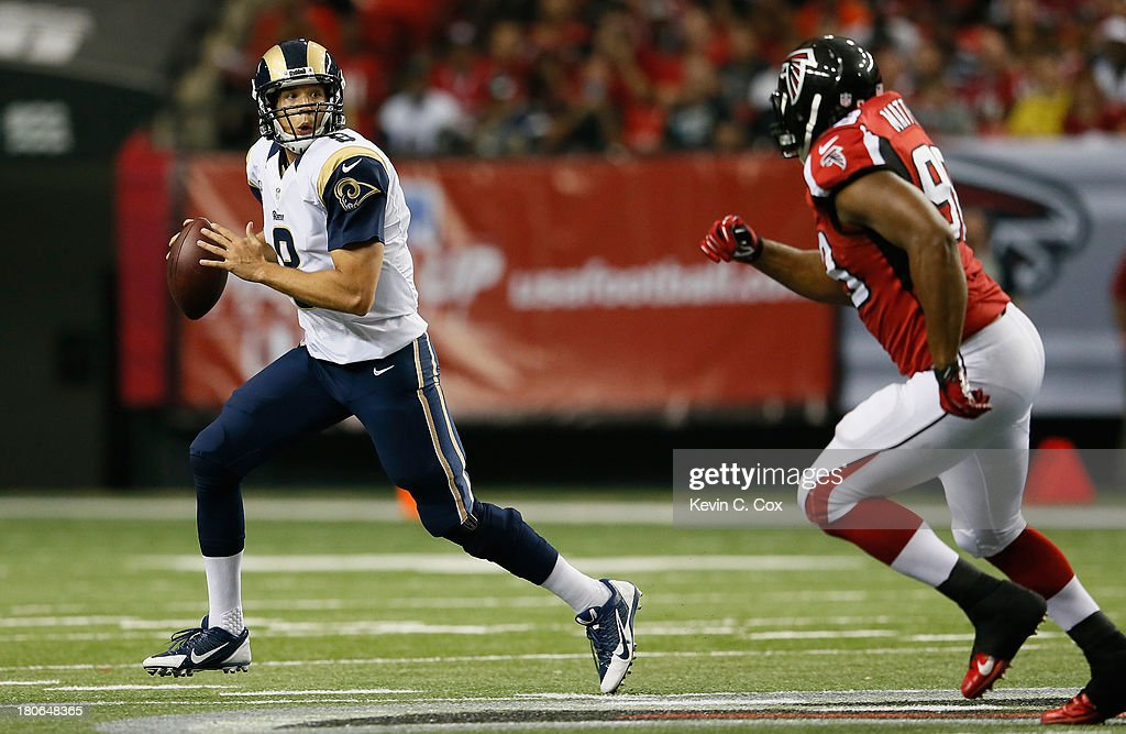 <a gi-track='captionPersonalityLinkClicked' href=/galleries/search?phrase=Sam+Bradford&family=editorial&specificpeople=4489292 ng-click='$event.stopPropagation()'>Sam Bradford</a> #8 of the St. Louis Rams scrambles away from <a gi-track='captionPersonalityLinkClicked' href=/galleries/search?phrase=Cliff+Matthews&family=editorial&specificpeople=5507696 ng-click='$event.stopPropagation()'>Cliff Matthews</a> #98 of the Atlanta Falcons at Georgia Dome on September 15, 2013 in Atlanta, Georgia.