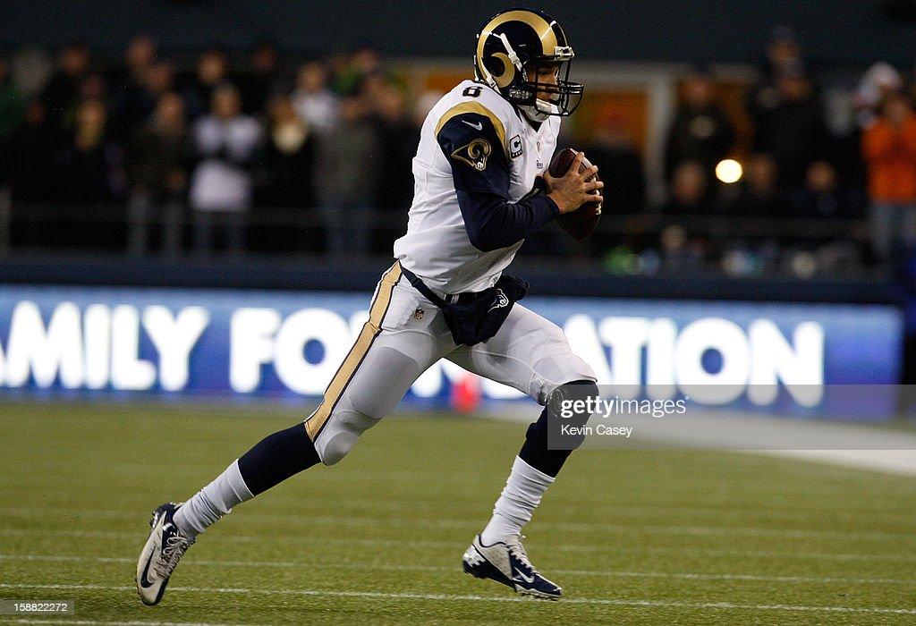 <a gi-track='captionPersonalityLinkClicked' href=/galleries/search?phrase=Sam+Bradford&family=editorial&specificpeople=4489292 ng-click='$event.stopPropagation()'>Sam Bradford</a> #8 of the St. Louis Rams scrambles in the first half against the Seattle Seahawks at CenturyLink Field on December 30, 2012 in Seattle, Washington.