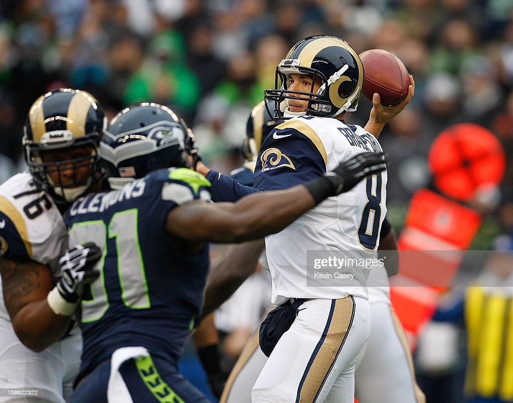 <a gi-track='captionPersonalityLinkClicked' href=/galleries/search?phrase=Sam+Bradford&family=editorial&specificpeople=4489292 ng-click='$event.stopPropagation()'>Sam Bradford</a> #8 of the St. Louis Rams throws in the first half against the Seattle Seahawks at CenturyLink Field on December 30, 2012 in Seattle, Washington.