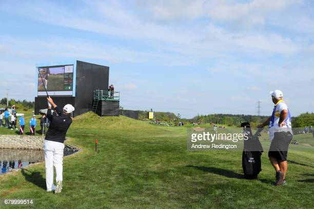 Sam Brazel of Australia hits a third shot on the 4th hole during the final match between Denmark and Australia during day two of GolfSixes at The...