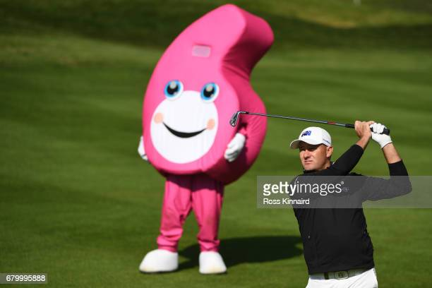 Sam Brazel of Australia hits an approach shot watched by the GolfSixes mascot during the final match between Denmark and Australia during day two of...