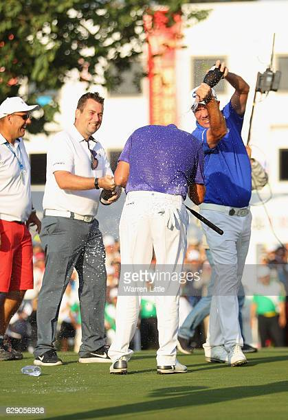 Sam Brazel of Australia is sprayed with champagne by Scott Hend of Australia after winning the UBS Hong Kong Open at The Hong Kong Golf Club on...