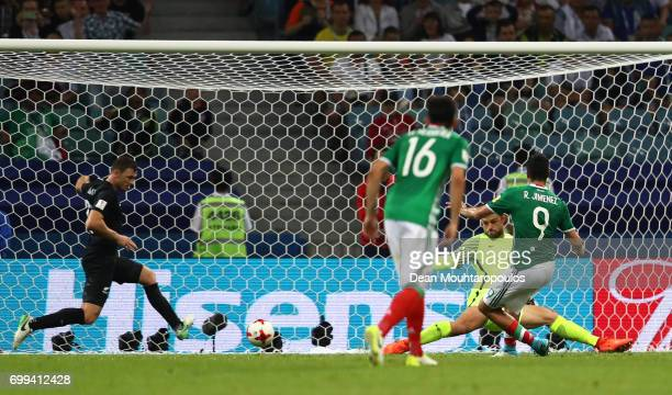 Sam Brotherton of New Zealand clears Raul Jimenez of Mexico shot off the line during the FIFA Confederations Cup Russia 2017 Group A match between...