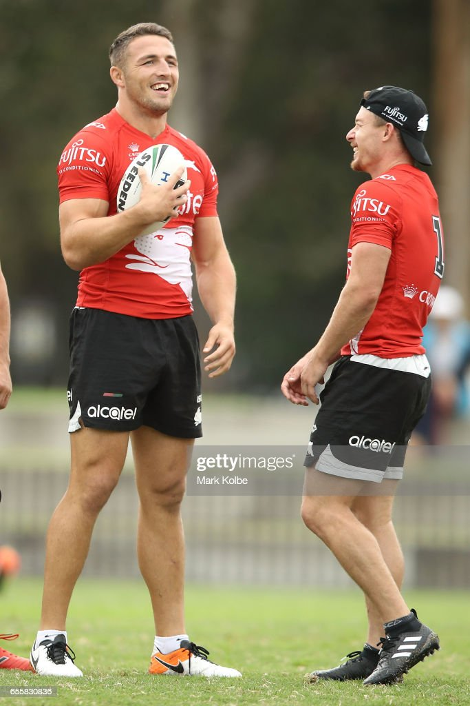 Sam Burgess and Damien Cook share a joke with team mates during a South Sydney Rabbitohs NRL training session at Redfern Oval on March 21, 2017 in Sydney, Australia.