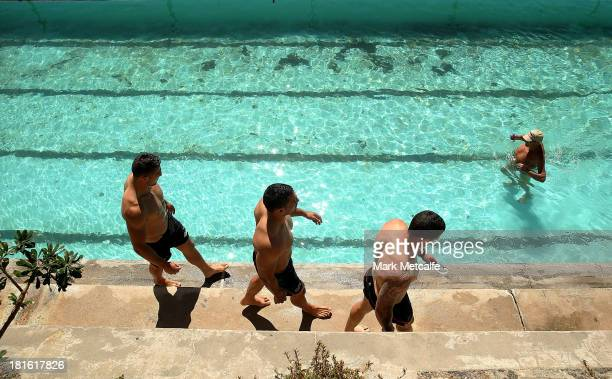 Sam Burgess Ben Te'o and Luke Burgess walk alongside a pool during a South Sydney Rabbitohs NRL recovery session at Clovelly Beach on September 23...