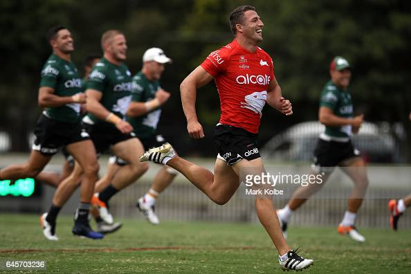 Sam Burgess laughs as he races team mates during the South Sydney Rabbitohs NRL training session at Redfern Oval on February 27 2017 in Sydney...