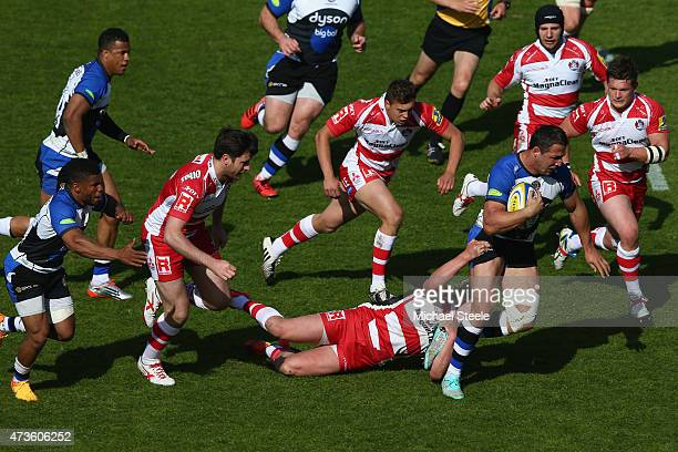 Sam Burgess of Bath bursts through the defence of Gloucester during the Aviva Premiership match between Bath Rugby and Gloucester Rugby at the...