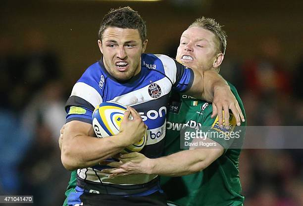 Sam Burgess of Bath holds off Tom Court during the Aviva Premiership match between Bath and London Irish at the Recreation Ground on April 24 2015 in...