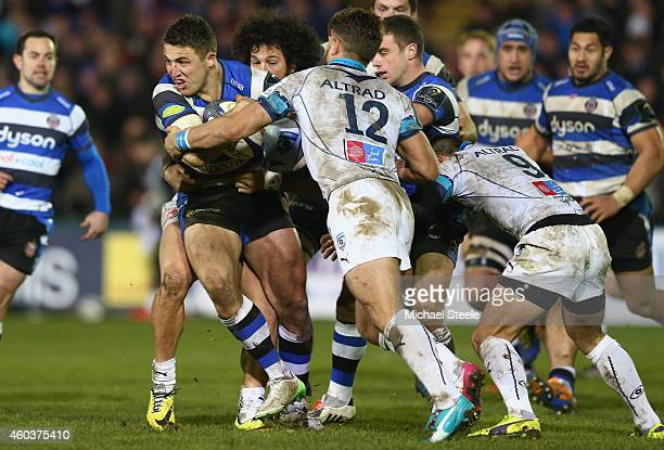 Sam Burgess of Bath is challenged by Wynand Olivier of Montpellier during the European Rugby Champions Cup Pool Four match between Bath Rugby and...