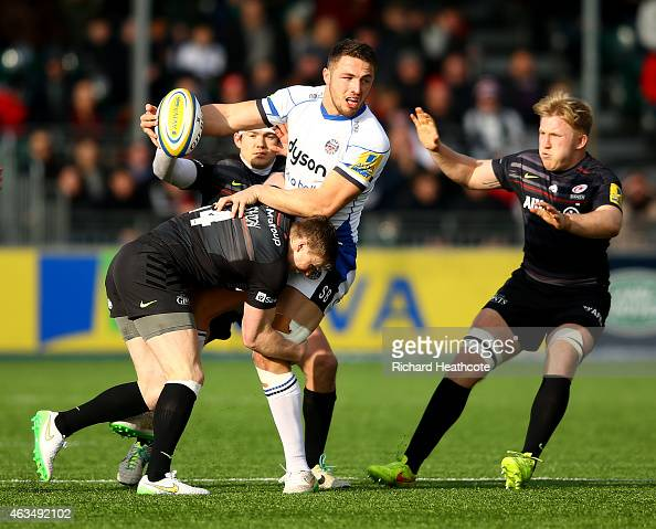 Sam Burgess of Bath is tackled by Chris Ashton of Saracens during the Aviva Premiership match between Saracens and Bath Rugby at Allianz Park on...