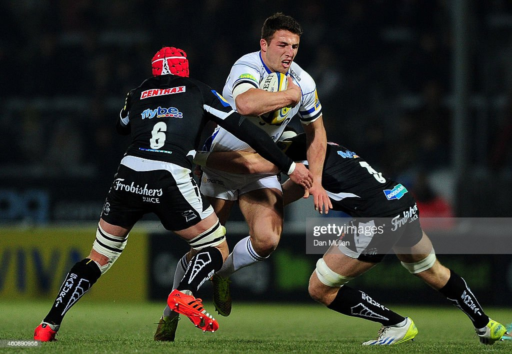 <a gi-track='captionPersonalityLinkClicked' href=/galleries/search?phrase=Sam+Burgess&family=editorial&specificpeople=2650353 ng-click='$event.stopPropagation()'>Sam Burgess</a> of Bath is tackled by <a gi-track='captionPersonalityLinkClicked' href=/galleries/search?phrase=Tom+Johnson+-+Rugby+Player&family=editorial&specificpeople=7678535 ng-click='$event.stopPropagation()'>Tom Johnson</a> and Ed Holmes of Exeter Braves during the Aviva Premiership A League match between Exeter Braves and Bath United at Sandy Park on December 29, 2014 in Exeter, England.