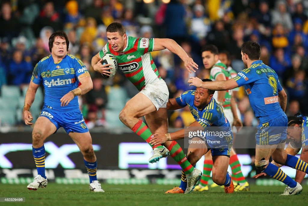 <a gi-track='captionPersonalityLinkClicked' href=/galleries/search?phrase=Sam+Burgess&family=editorial&specificpeople=2650353 ng-click='$event.stopPropagation()'>Sam Burgess</a> of the Rabbitohs breaks the Eels defence during the round 19 NRL match between the Parramatta Eels and the South Sydney Rabbitohs at Pirtek Stadium on July 18, 2014 in Sydney, Australia.